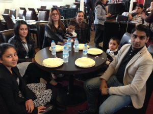 Eager eaters: The Nadeem family get ready to tuck in.